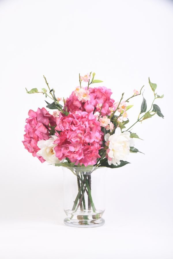 Hydrangeas and Pink Wildflowers in a Glass Vase