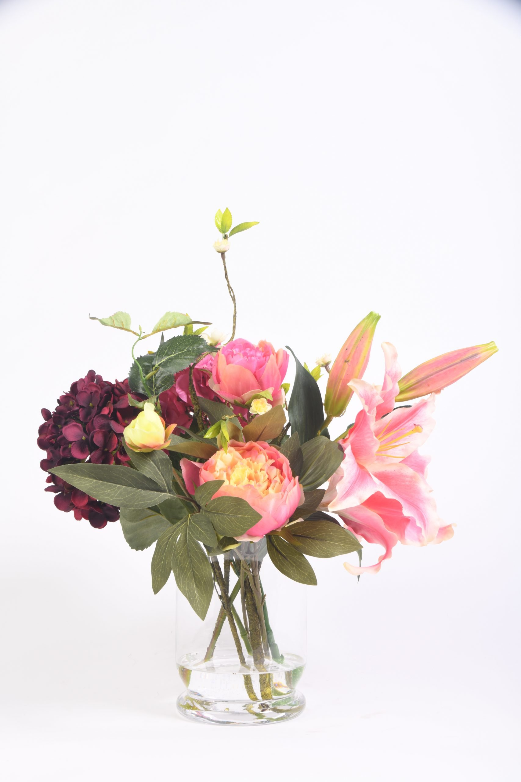 Poppies, Lilies, and Hydrangeas in a Glass Vase